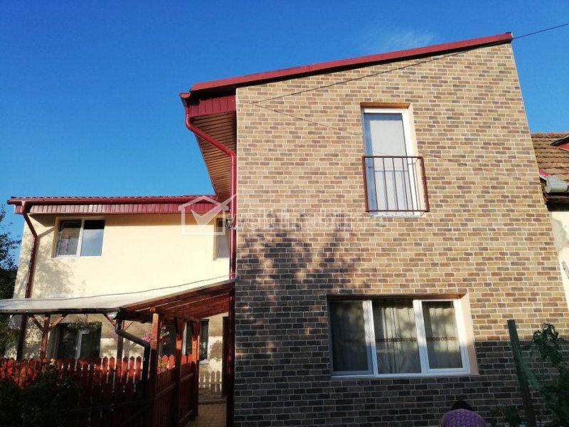 Casa in zona linistita, curte, garaj, bucatarie de vara