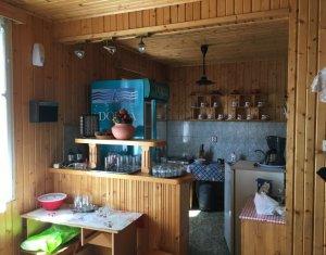 Cabana-Pensiune la 2km de lac Belis, teren 1500mp, cazare 18pers